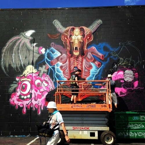 Day 2 Recap: Progress of a new mural by @nychos and @buffmonster for #powwowhawaii. @marthacoopergram capturing the moments. Photo by @1xrun. @rvca @montanacans @flexfit @hawaiianairlines #rvcatwfsl #pmalohatour