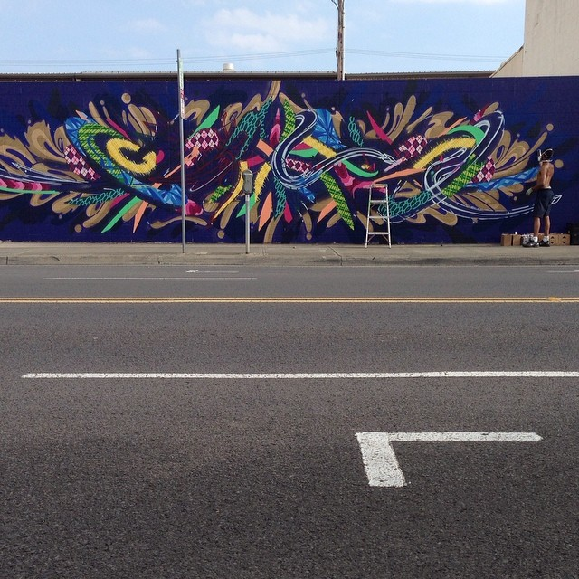 Day 4: New mural in progress by @apexer for #powwowhawaii. @rvca @montanacans @flexfit @hawaiianairlines