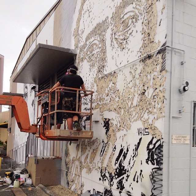 Day 5: New mural in progress by @vhils for #powwowhawaii. @rvca @montanacans @flexfit @hawaiianairlines