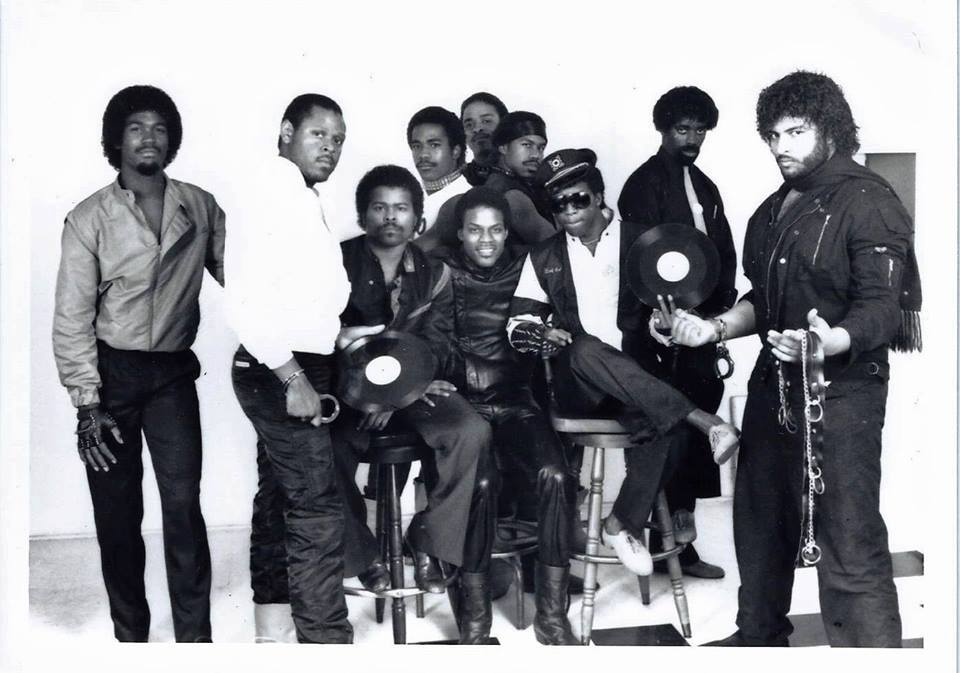 "Uncle Jamm's Army, L to R: George ""Mr No Good"" Hatchet, Rodger ""Mister Prince"" Clayton, Tommie ""Tomcat"" Richardson, Lester Malone, Gid Martin, Troy Johnson, Dwayne ""Muffla"" Simon, Bobby ""Bobcat"" Ervin, Duane ""Razor"" Meadows, Greg ""The Egyptian Lover"" Broussard"